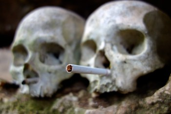 Tana Toraja - human skulls in ancient funeral caves with cigarette donation for the spirits Christian Jansen & Maria Düerkop