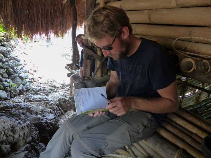 Sumba - Chris and the guestbook of the village Christian Jansen & Maria Düerkop