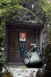 Tana Toraja - ornamented door to stone grave with picture and personal belongings of deceased Christian Jansen & Maria Düerkop