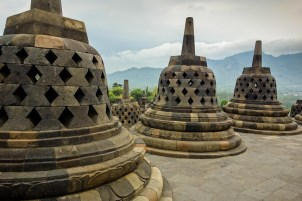 Yogyakarta - Borobodur temples: Bell like stupas enclose hundreds of Buddha statues Christian Jansen & Maria Düerkop