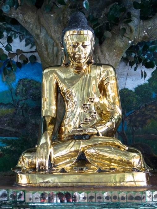Yangon - Golden sitting Buddha at Shwedagon Pagoda Christian Jansen & Maria Düerkop
