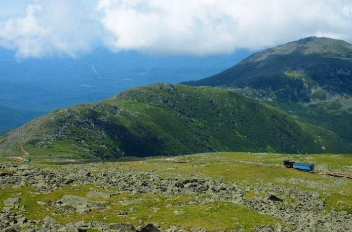 The Mount Washington Cog Railway takes you for a ride up the highest mountain in New England and through stunning mountain landscapes and nature.