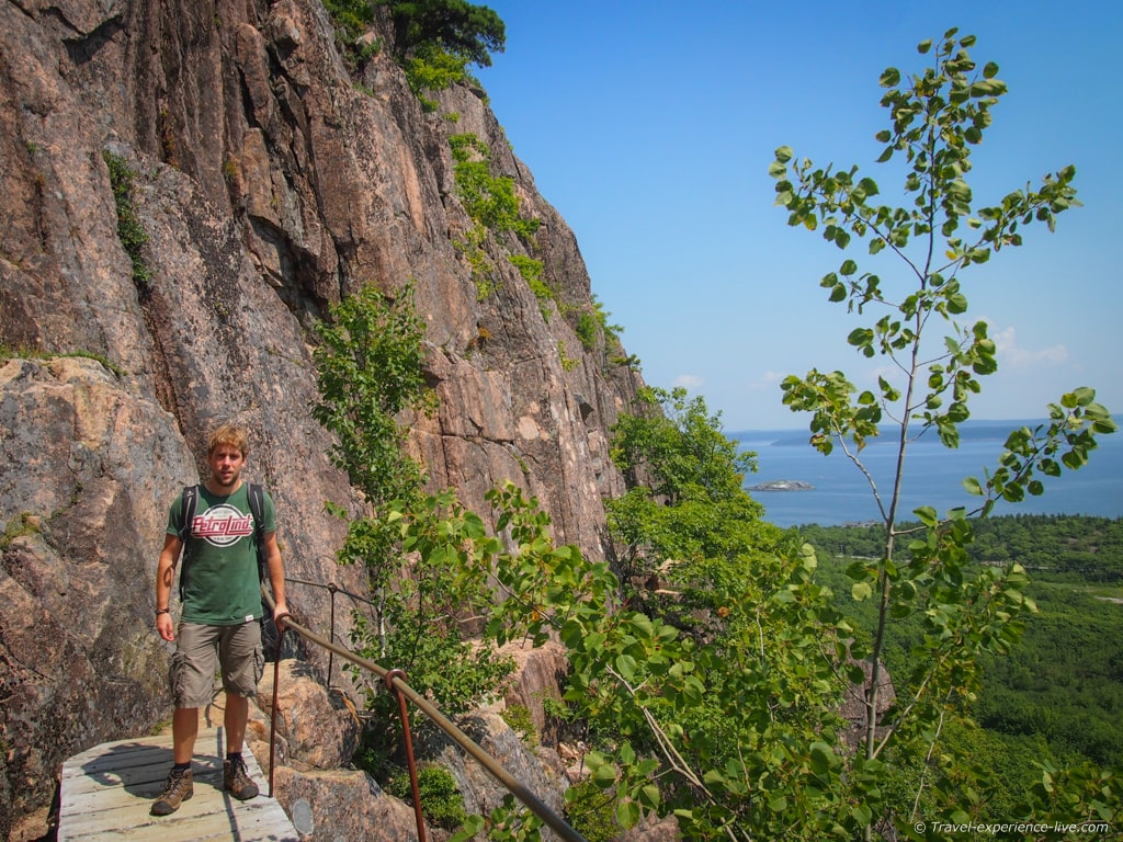 Hiking the Precipice Trail up Champlain Mountain, Maine.