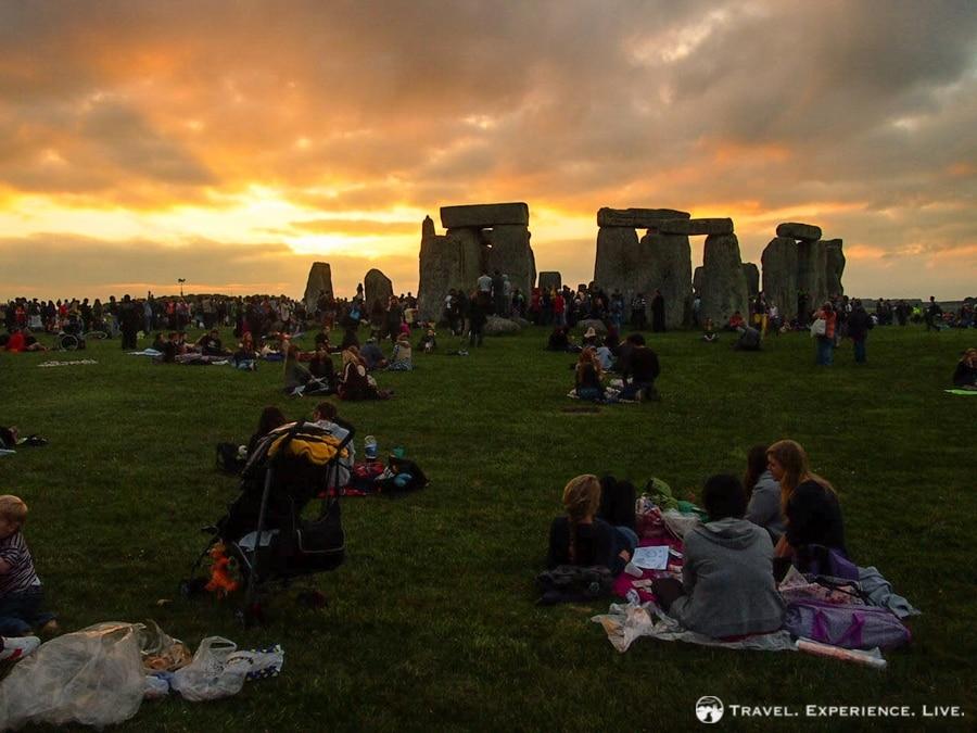 People enjoying a beautiful sunset at Stonehenge