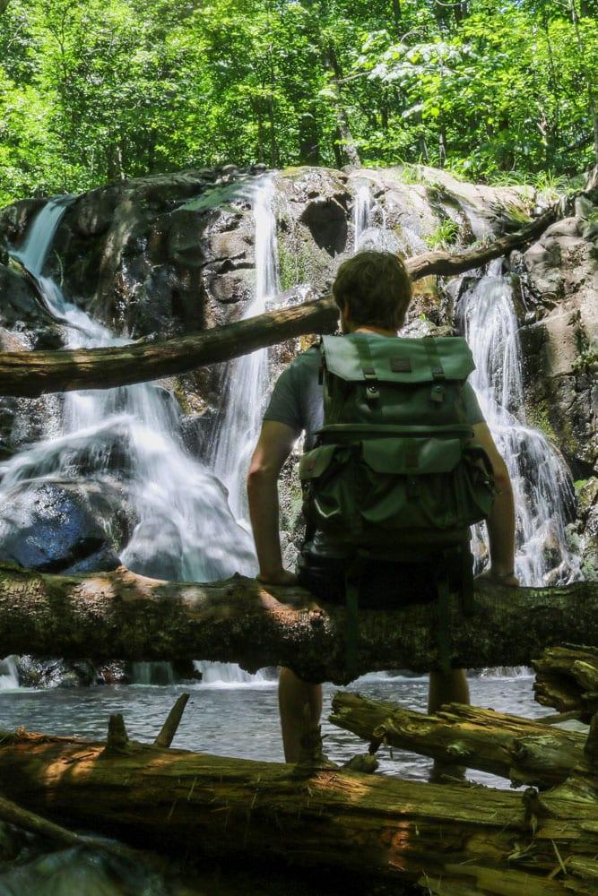 Backpacker at Rose River Falls, Shenandoah National Park