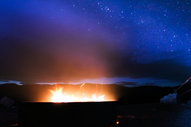 Campfire and stars in Great Sand Dunes National Park