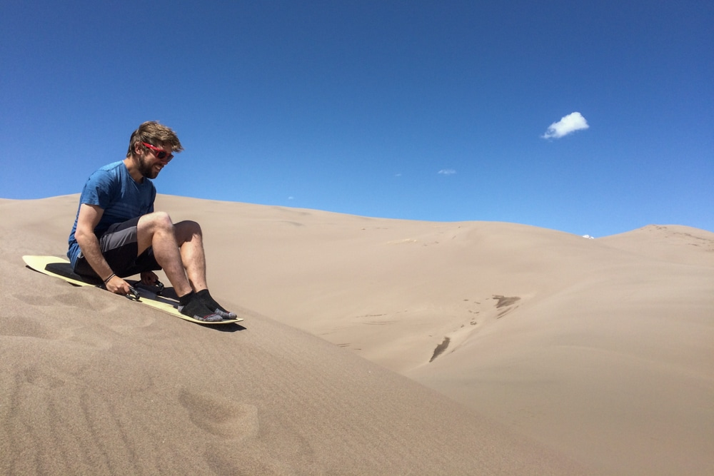 Sand sledding in Great Sand Dunes National Park, Colorado