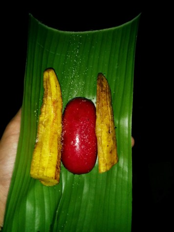 "Late-night roadside food. ""PNG hot dog"": two plantains and a dubious sausage"