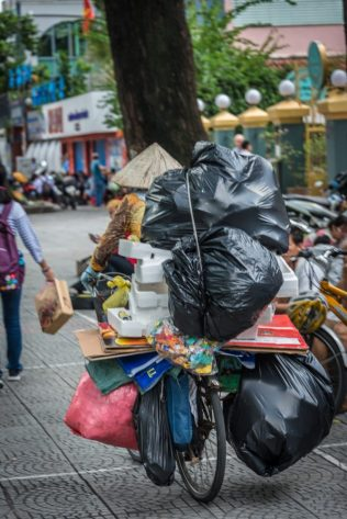 Travel Photo of People taking the trash in Vietnam