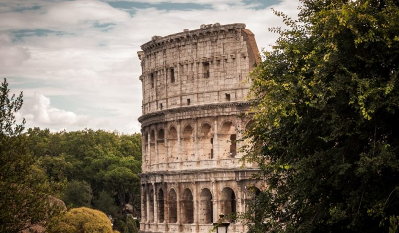 View of the Colosseum from the outside on an old Roman street