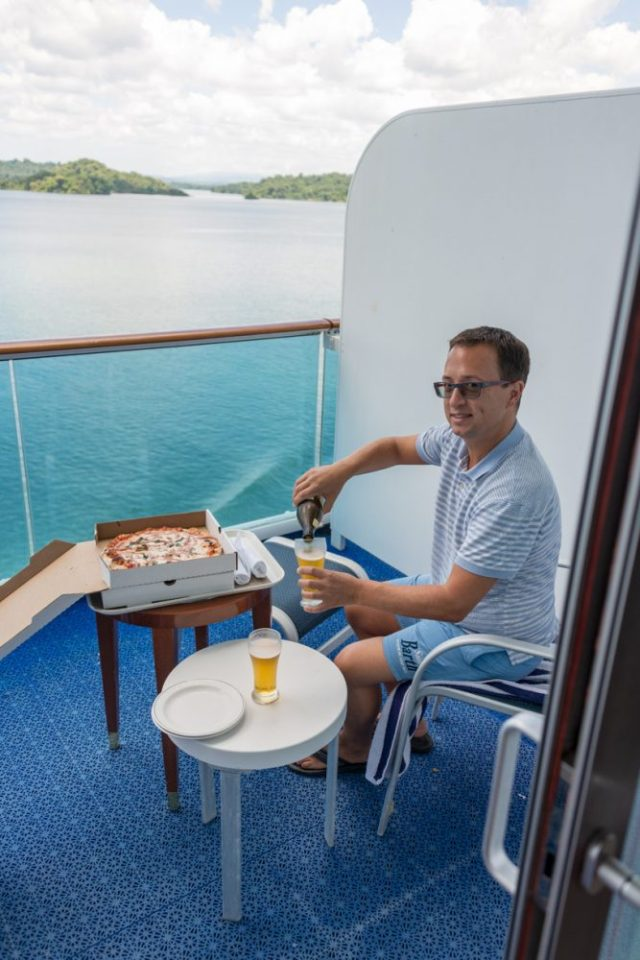 Rick Having Pizza and Beer - On an upgraded Balcony Cabin