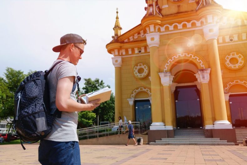 Man touring a city and traveling solo