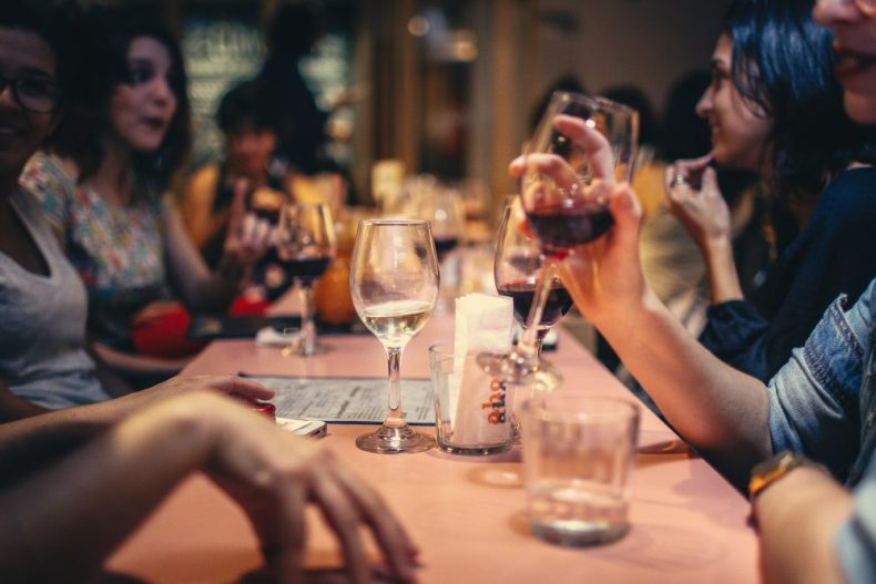 People sharing a table and having drinks - A great idea for those who travel solo