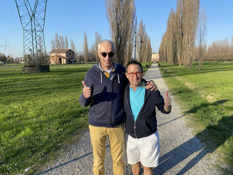 Rick and Andrea walking in the park before writing about what its like living in italy amid the covid-19 coronavirus emergency