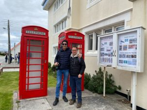 Rick and Andrea by a British Telephone Booth in Stanley, Falkland Islands on our Cruise to South America
