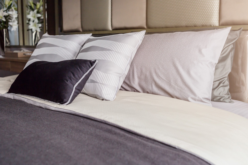 bed gray covers, white pillows
