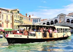 Vaporetto with Rialto Bridge in the background