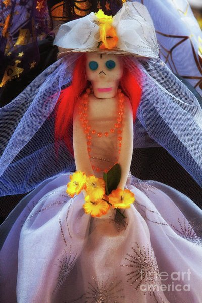 Catrina candy dool as a bride for La Dia De Los Muertos, Mexico