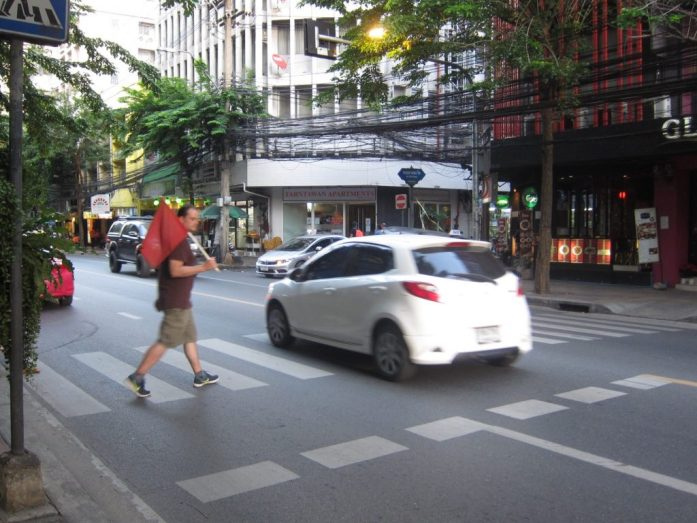 Crossing the street in Bangkok, Thailand