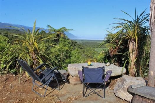 camp chair and coffee with bush views