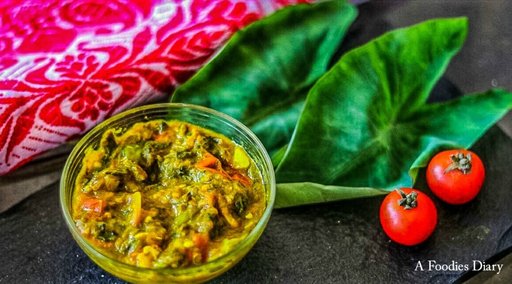 Authentic Assamese Food: Kosuthuri Kon Bilahir Logot (Tender Colocasia Leaves cooked with Cherry Tomatoes)