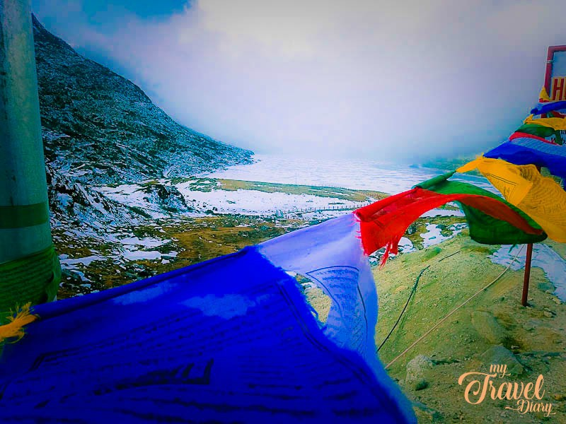 Breathtaking snow covered sela lake with colorful prayer flags