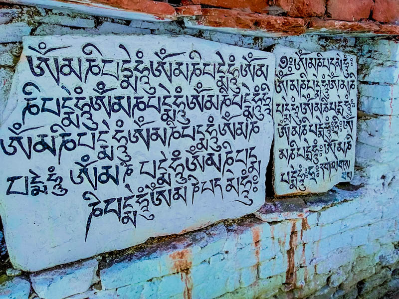 Buddhist script written on rock