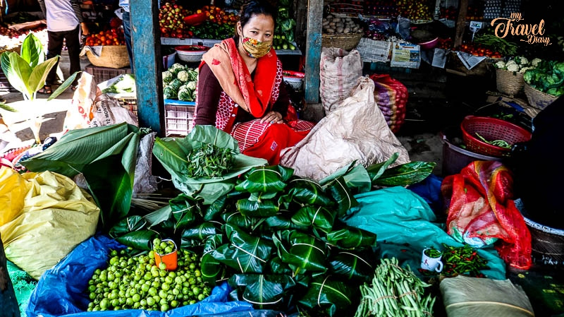 Woman selling vegetables at the local market of Aalo