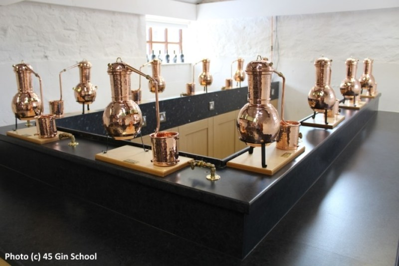 Miniature stills in the classroom at Jamie Baxter's Gin School at the 45 West Distillery near Loughborough in England