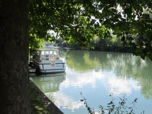 A boat on the River Charente by the Louis Royer Distillery