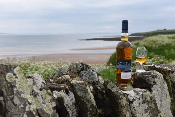 Scapa_Distillery_Orkney_Scotland_view_with_bottle_and_glass