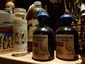 Part of the historic spirits collection at the Clumsies bar in Athens