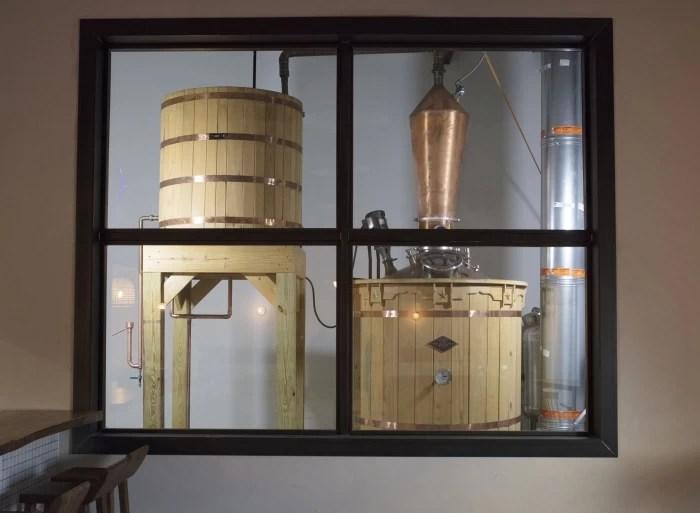 Wooden fermentation vats and still at the Desert Door Texas Sotol Distillery