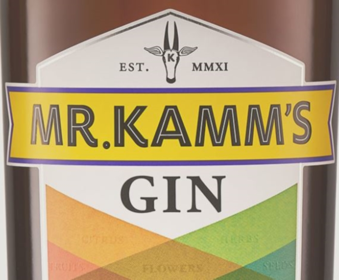 The label of a bottle of Mr Kamm's Gin being reviewed by Travel Distilled.
