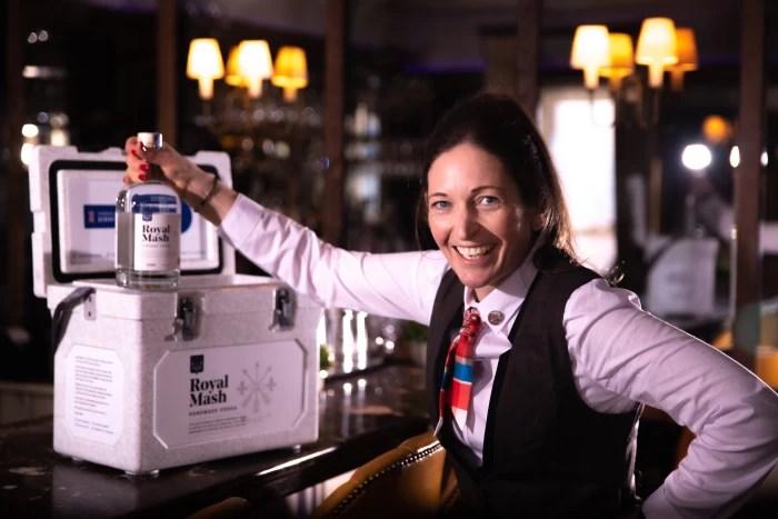 Royal Mash Vintage Vodka in a bar with a bartender