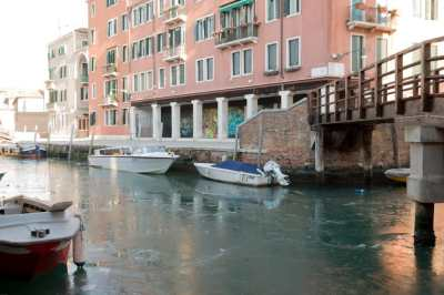 Boats on an icy Venetian canal
