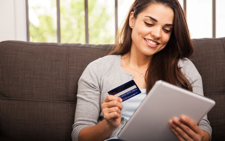 Woman making an online purchase and practicing online identity theft prevention