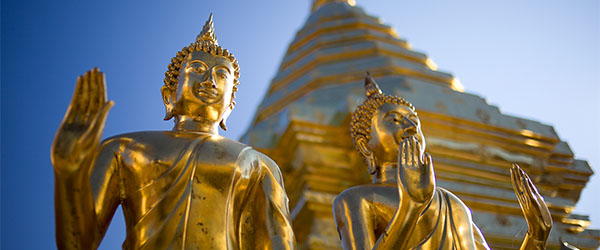 A look at some golden statues in front of a temple in Chiang Mai in Northern Thailand.