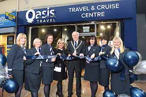 Mayor of North Down, Alan Graham, and Sandra Corkin at the opening to the new Oasis Travel Bangor branch with the Bangor team (l-r) Jill McBurney, Heather Mitchell, Manager Lynn Jamison, Nicola Ferris, Melanie Harper and Deborah Stewart.