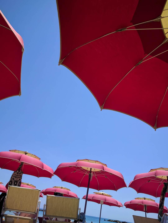 Red beach umbrellas and sky