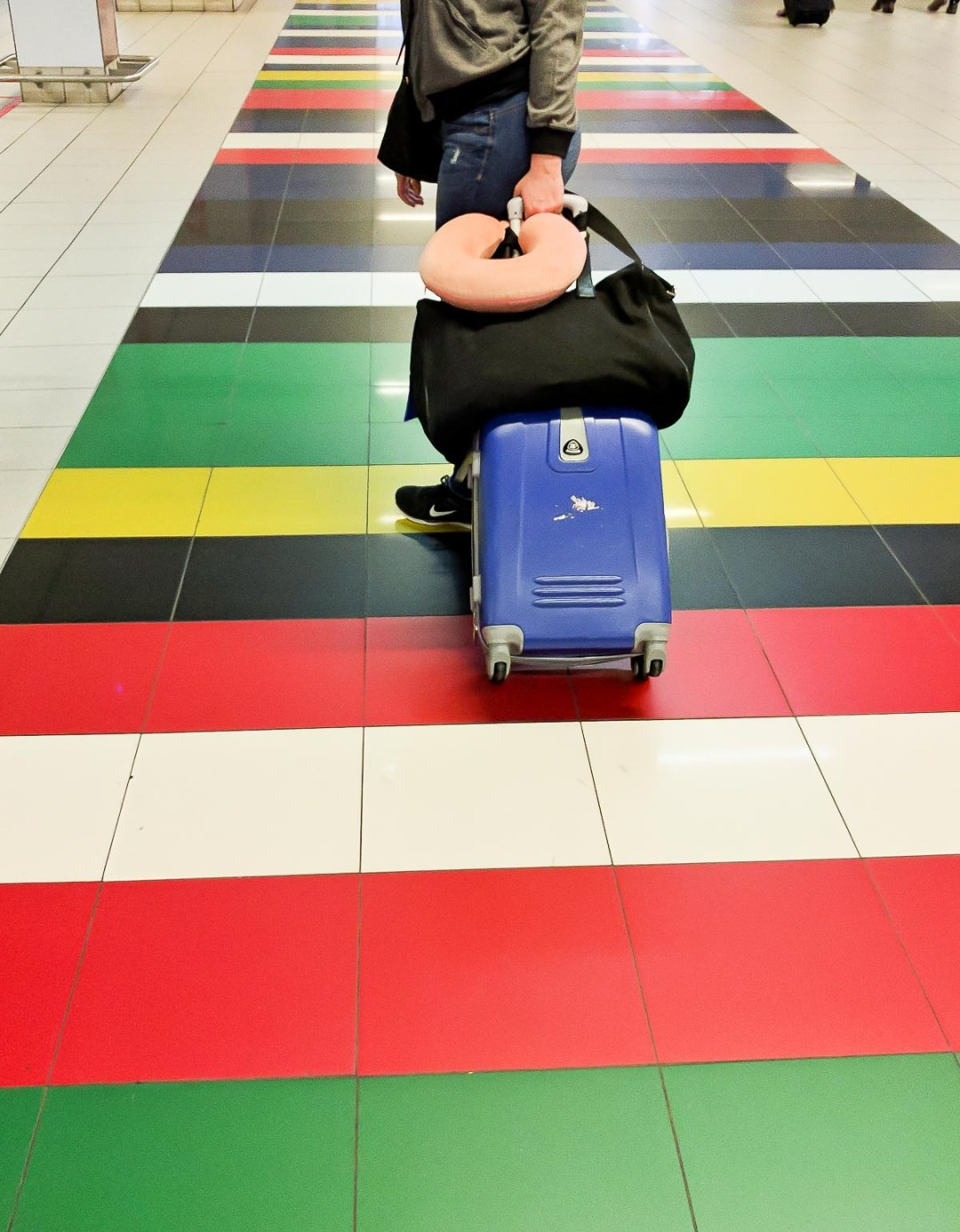 luggage on a bright colored floor