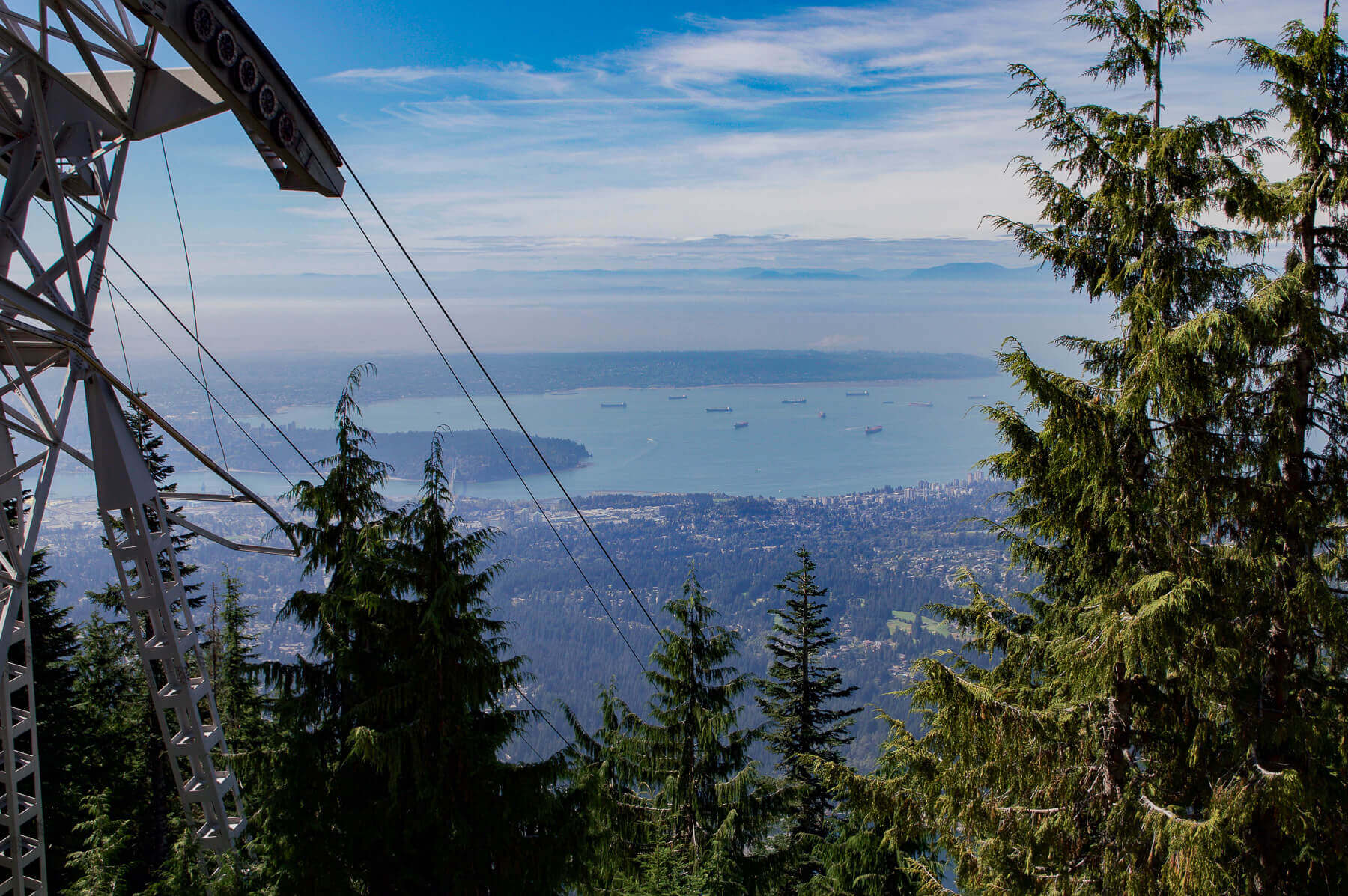 A view of the ocean, forest and city from Grouse Mountain