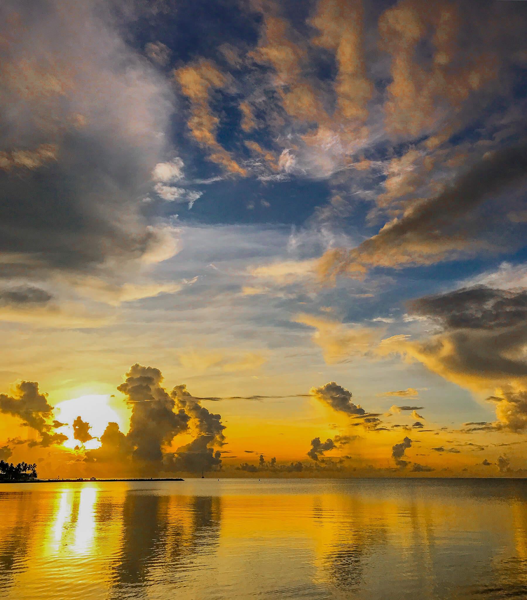 Bright orange sunset over ocean in Fiji