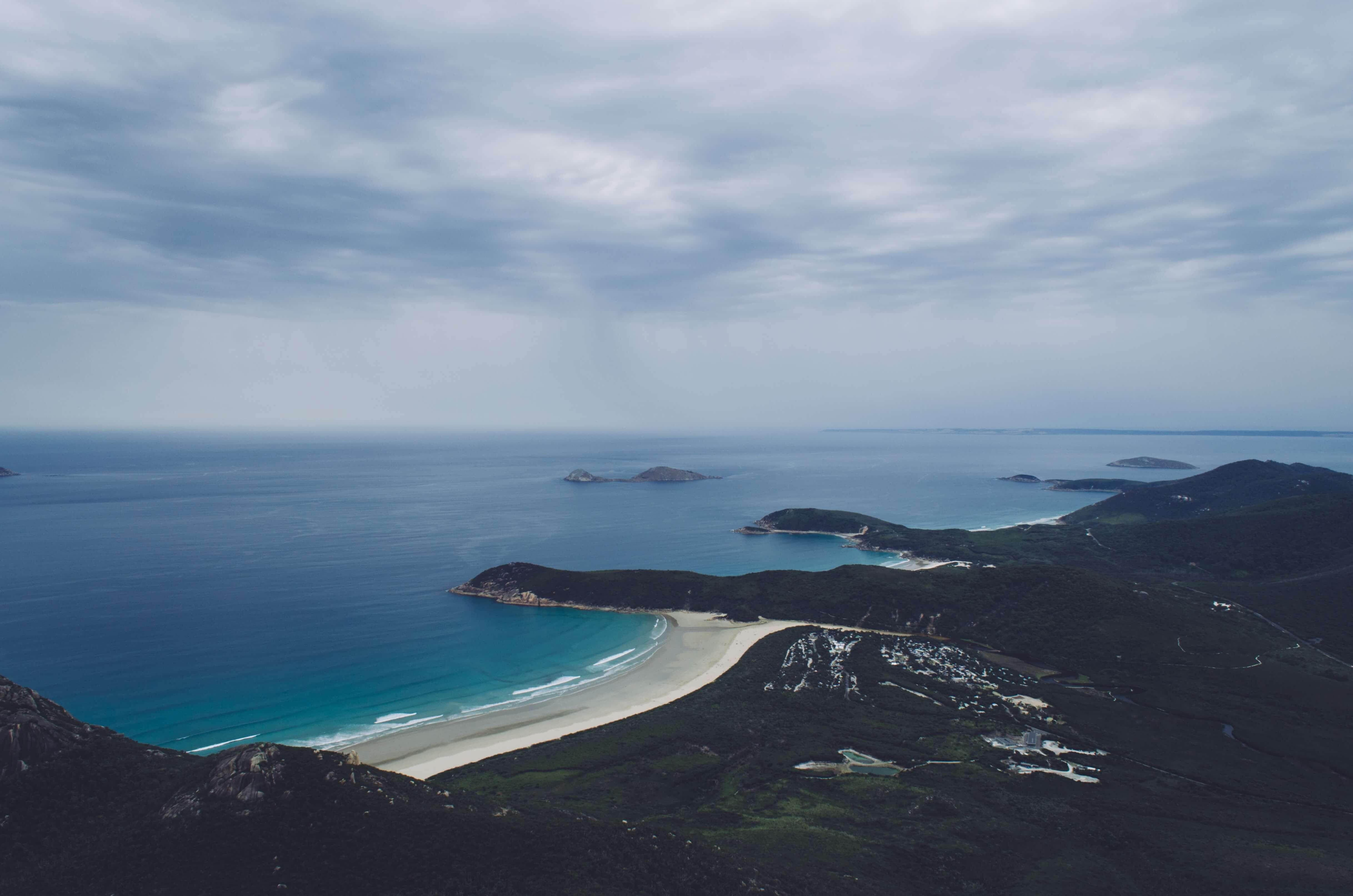 grey skies above beach and rugged Australian coast