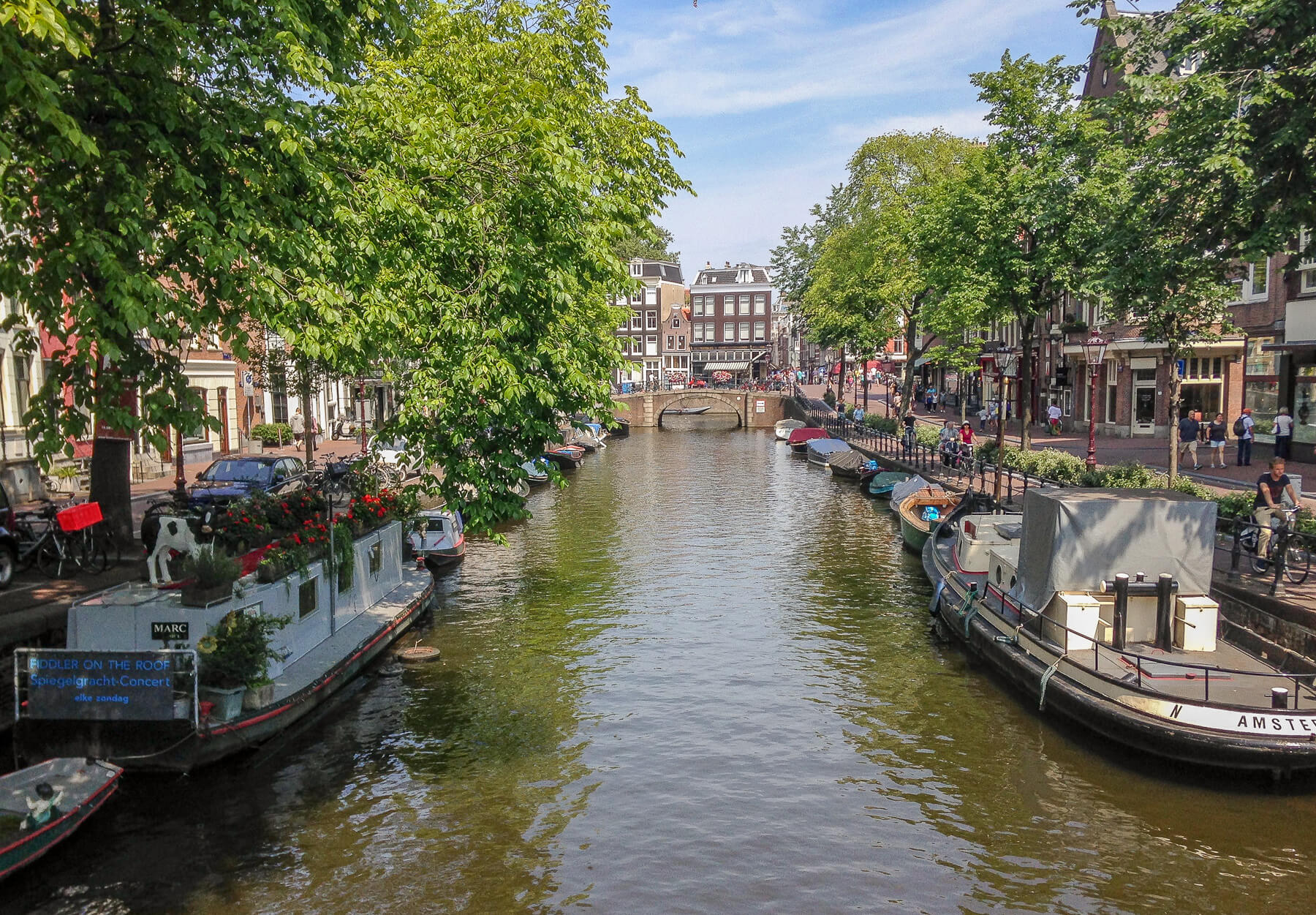 Amsterdam Canal with houseboats along the edges