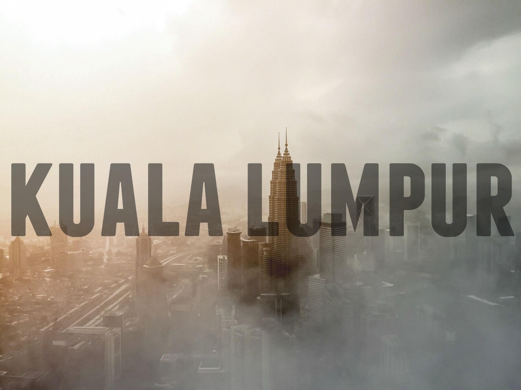 Foggy Kuala Lumpur skies with text overlay - Kuala Lumpur