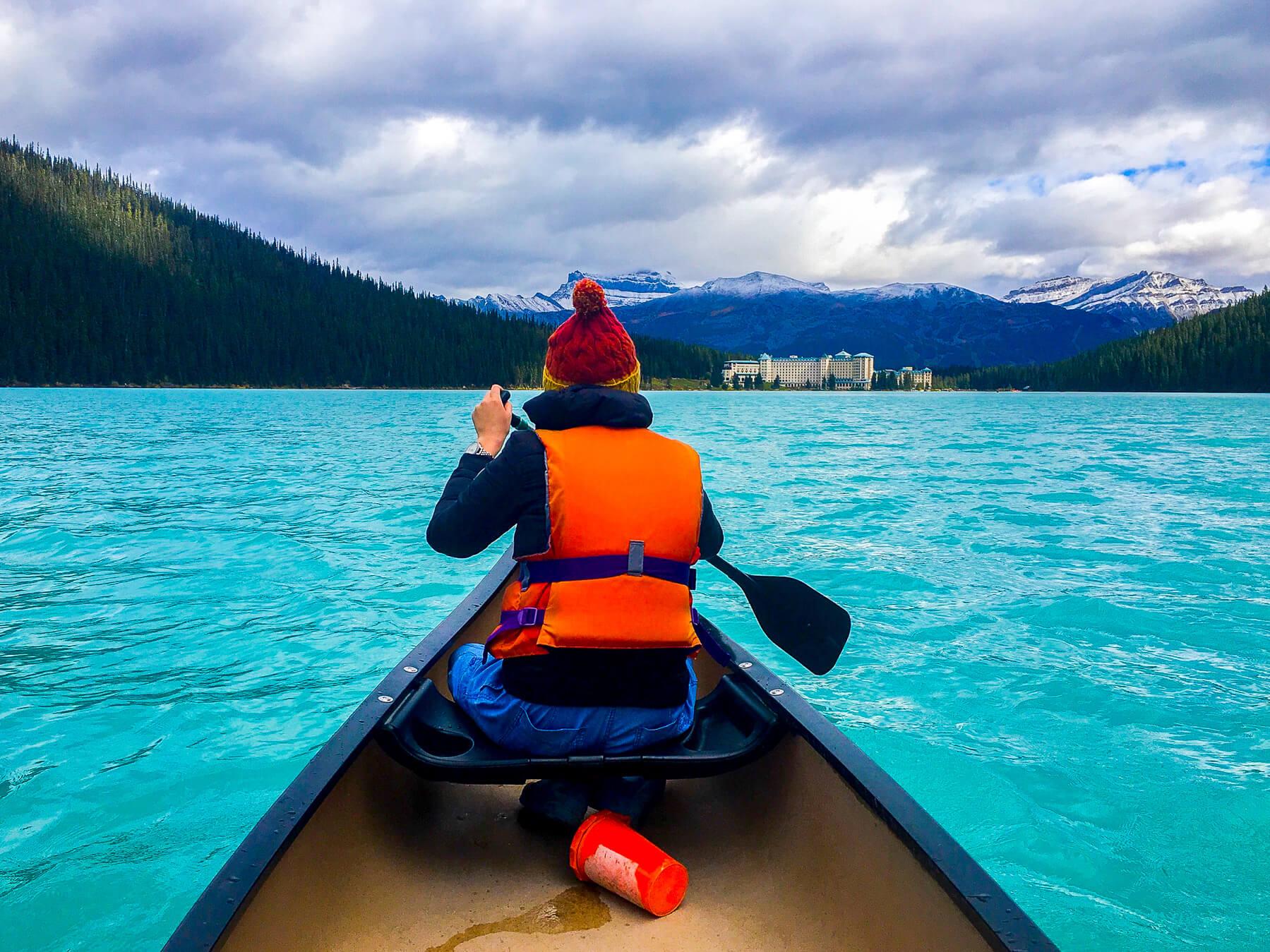 Girl canoeing on Lake Louise - Turquoise water