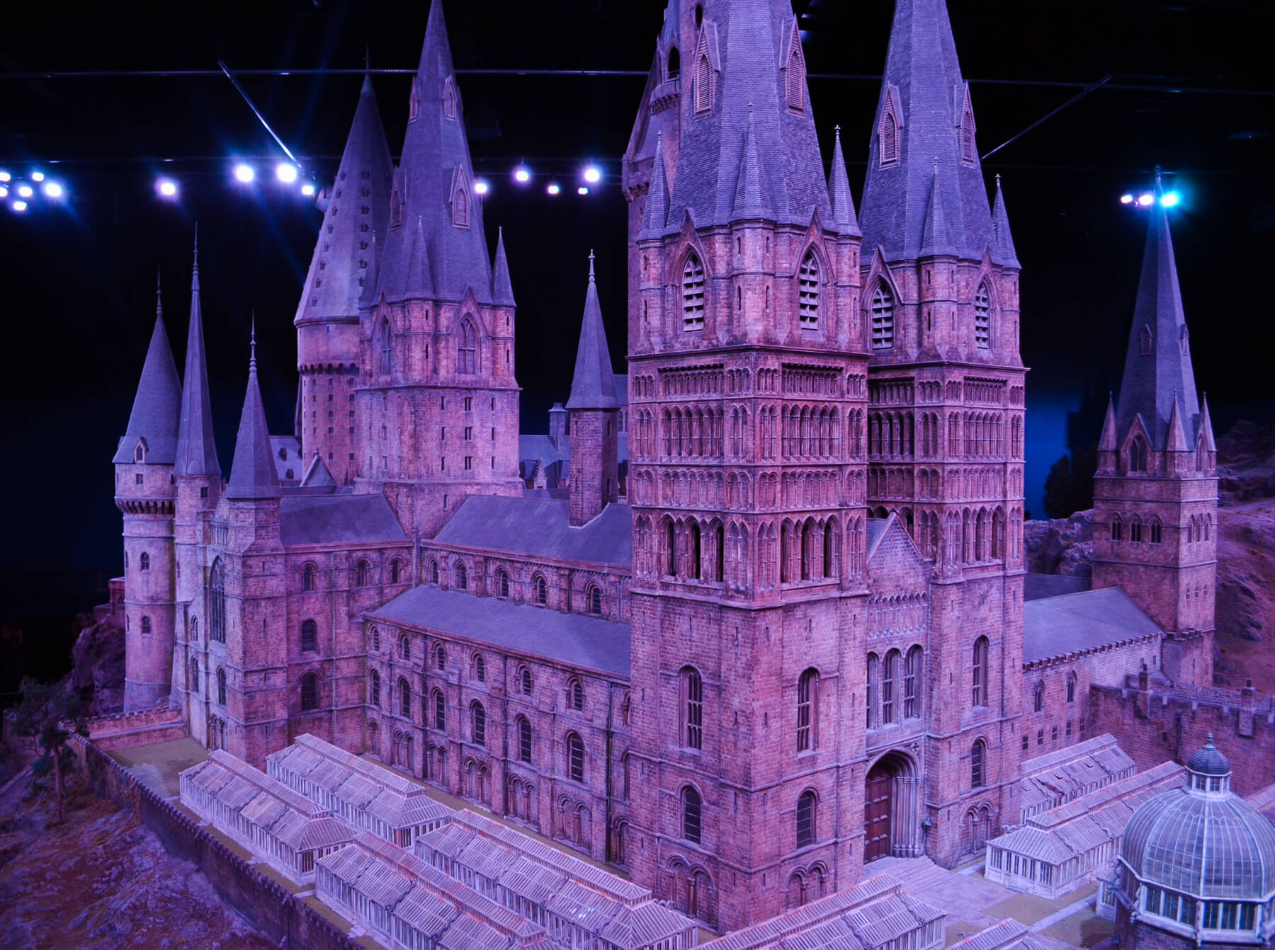 purple lighting on huge model castle