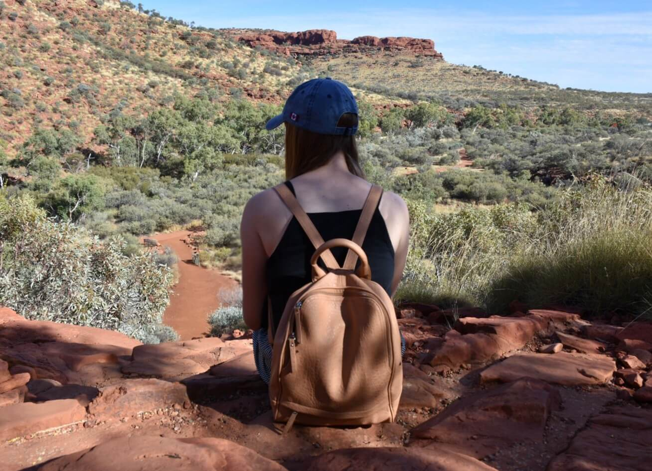 Girl in Blue hat facing away from Camera overlooking Kings Canyon