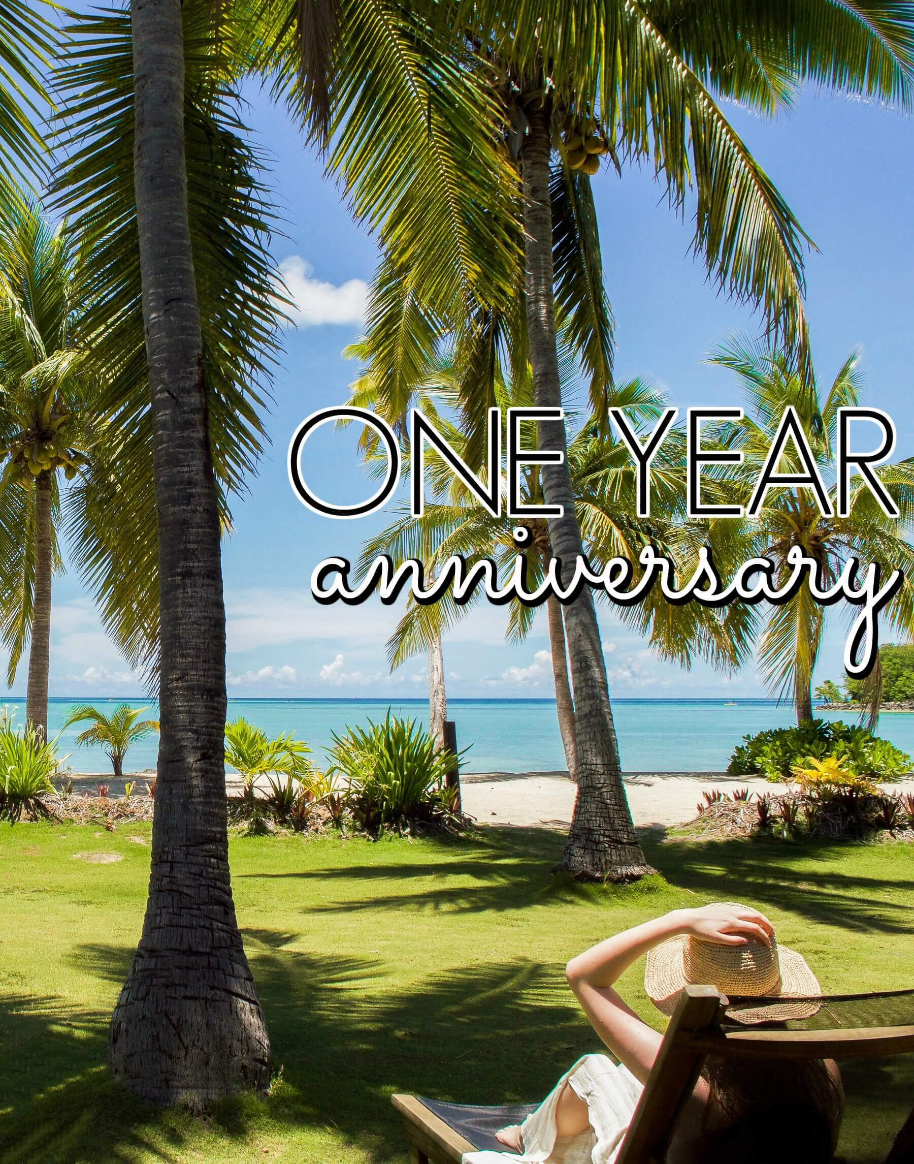 "Girl sitting on deck-chair under palm trees - infront of ocean. With text ""One Year Anniversary"""